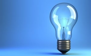 Illustration of incandescent light-bulb on blue background - 3d render