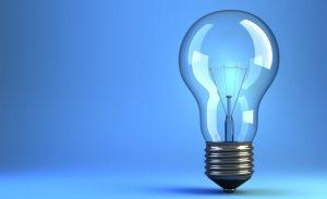 Illustration of incandescent light-bulb on blue background - 3d render